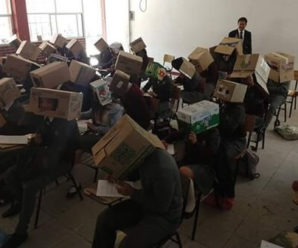 At a school in Tlaxcala, Mexico, the teacher placed a cardboard box on the students' heads to stop cheating. Whose picture is becoming quite viral on social media.